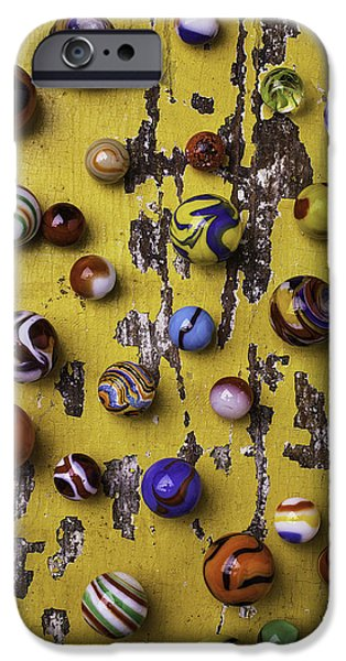 Marble iPhone Cases - Marbles On Yellow Wooden Table iPhone Case by Garry Gay