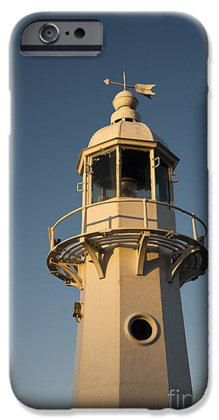 Head Harbour Lighthouse iPhone Cases - Mevagissey Lighthouse in the Evening iPhone Case by Anne Gilbert