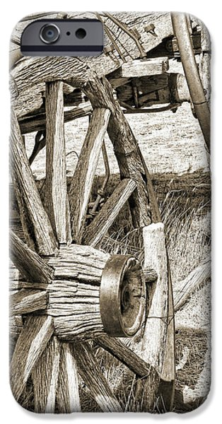 Montana Old Wagon Wheels in Sepia iPhone Case by Jennie Marie Schell