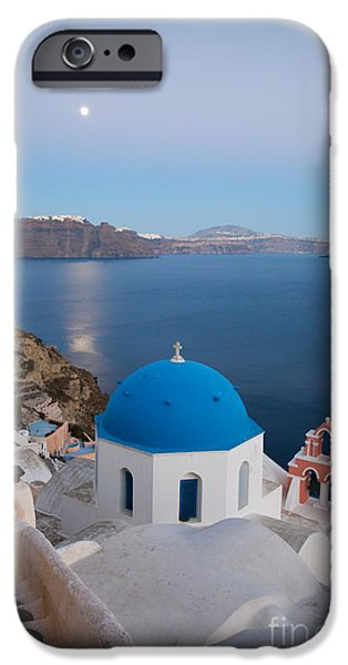 Moon over blue domed church in Oia Santorini Greece iPhone Case by Matteo Colombo