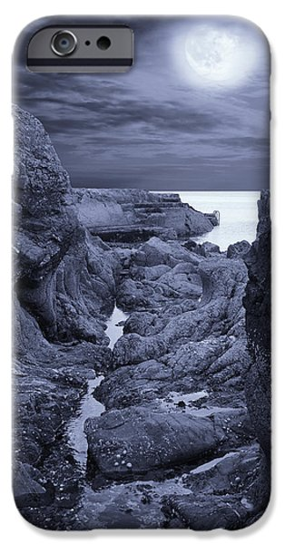 Eerie iPhone Cases - Moonlight over Rugged Seaside Rocks iPhone Case by Jane McIlroy