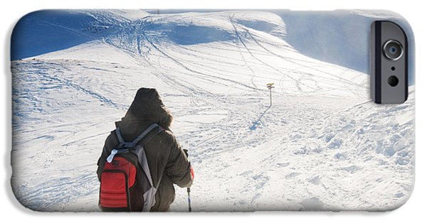 Snowy Day iPhone Cases - Mountain trekking iPhone Case by Michal Bednarek