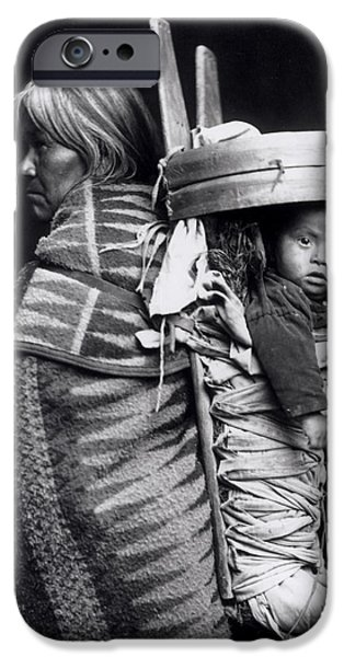 Textile Photographs iPhone Cases - Navaho woman carrying a papoose on her back iPhone Case by William J Carpenter