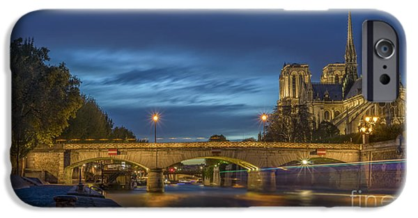 Universities Pyrography iPhone Cases - Notre Dame de Paris in the evening lights iPhone Case by Vyacheslav Isaev