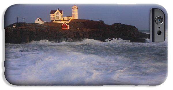 Nubble Lighthouse iPhone Cases - Nubble Lighthouse Holiday Lights and High Surf iPhone Case by John Burk