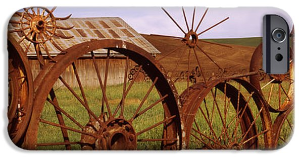 Built Structure iPhone Cases - Old Barn With A Fence Made Of Wheels iPhone Case by Panoramic Images