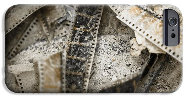 Film Pyrography iPhone Cases - Old film on the floor iPhone Case by Oliver Sved