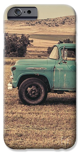 Old Trucks Photographs iPhone Cases - Old Hay truck in the field iPhone Case by Edward Fielding