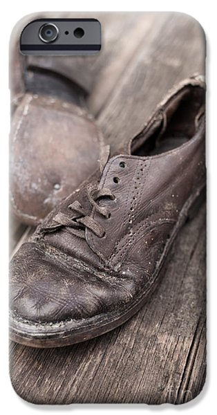 Child iPhone Cases - Old leather shoes on wooden floor iPhone Case by Edward Fielding