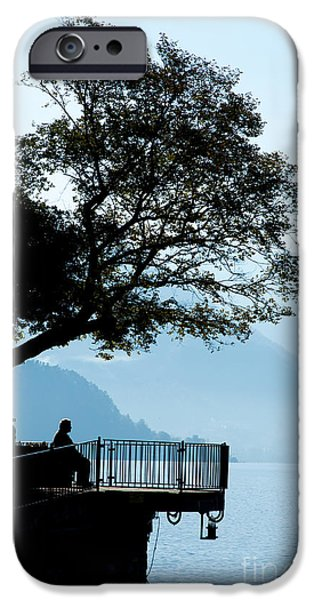 Overhang iPhone Cases - Old Man Sitting In Shade Of Tree Overlooking Lake Como iPhone Case by Peter Noyce
