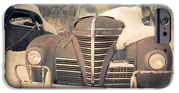 Stormy Weather iPhone Cases - Old Plymouth classic car in the snow iPhone Case by Edward Fielding