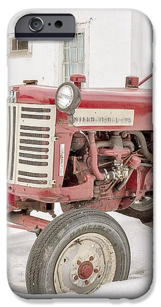 Old Red Tractor in the snow iPhone Case by Edward Fielding