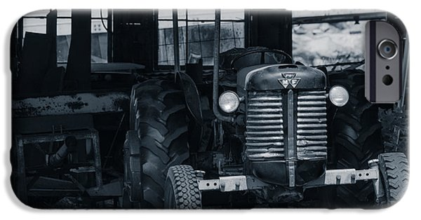 Nebraska Photographs iPhone Cases - Old tractor in the barn iPhone Case by Edward Fielding