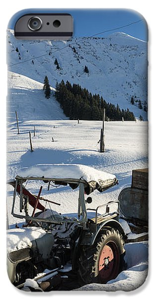 Old tractor in winter with lots of snow waiting for spring iPhone Case by Matthias Hauser