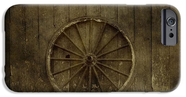 Wooden Wagons iPhone Cases - Old Wagon Wheel On Barn Wall iPhone Case by Dan Sproul