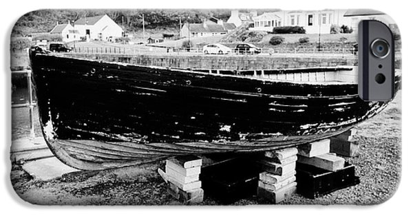 Overcast Day iPhone Cases - Old Wooden Fishing Boat In Portpatrick Harbour Scotland Uk iPhone Case by Joe Fox