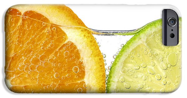 Isolated iPhone Cases - Orange and lime slices in water iPhone Case by Elena Elisseeva