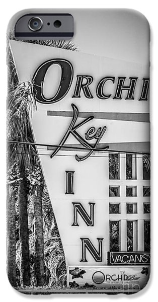 White Orchid iPhone Cases - Orchid Inn Sign Key West - Black and White iPhone Case by Ian Monk