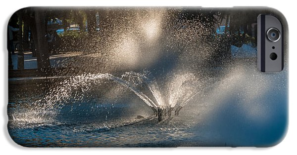 Fontain iPhone Cases - Ornamental fountain in a pond with blurred light reflections iPhone Case by Hannelore Baron