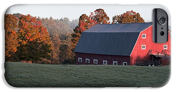 Foliage iPhone Cases - Panoramic view of a red barn at sunrise iPhone Case by Edward Fielding