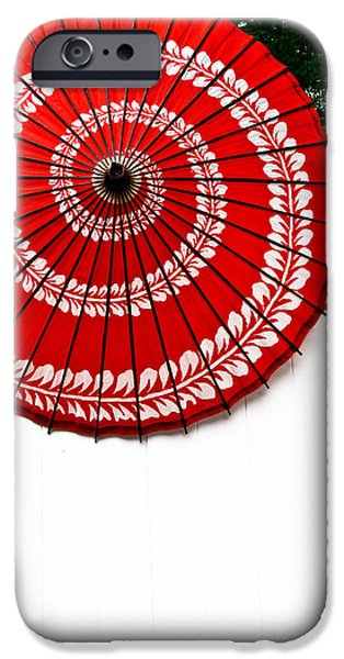 Paper Umbrella with Swirl Pattern on Fence iPhone Case by Amy Cicconi