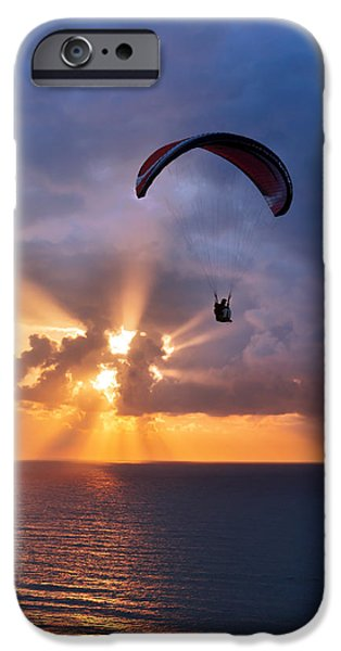 Sunset iPhone Cases - Paragliding At Sunset On Sea With Sun Beams iPhone Case by Mikel Martinez de Osaba