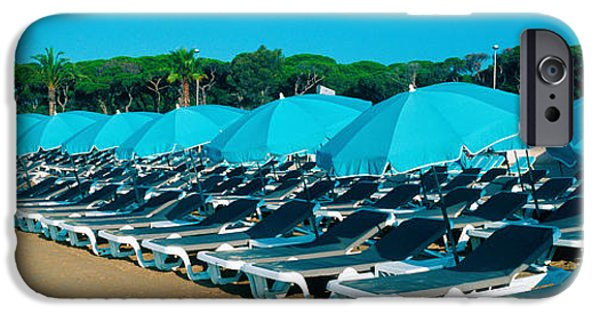 Absence iPhone Cases - Parasols With Lounge Chairs iPhone Case by Panoramic Images