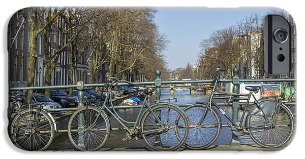 Canal Street Line iPhone Cases - Parked bikes on a bridge in Amsterdam iPhone Case by Patricia Hofmeester