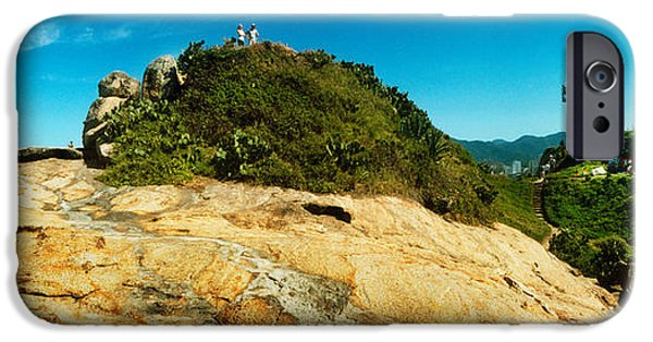 Beach Landscape iPhone Cases - People On Boulders That Separate iPhone Case by Panoramic Images