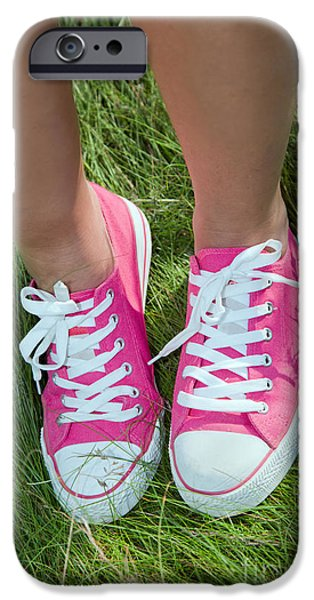 Sneaker iPhone Cases - Pink sneakers on girl legs on grass iPhone Case by Michal Bednarek
