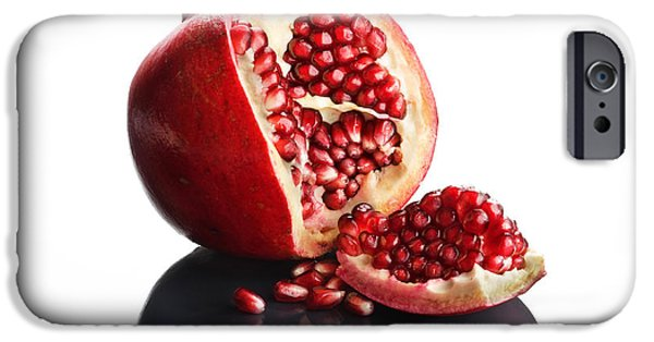 Slices iPhone Cases - Pomegranate opened up on reflective surface iPhone Case by Johan Swanepoel
