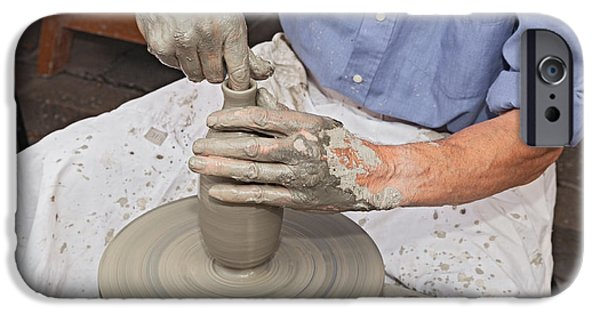 Hand Thrown Pottery Photographs iPhone Cases - Potter Shaping Clay On A Potters Wheel  iPhone Case by Ermess Images