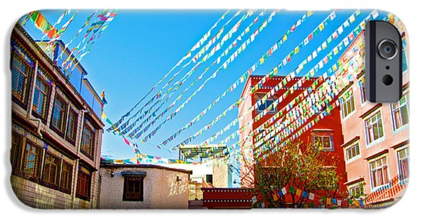 Tibetan Buddhism Digital iPhone Cases - Prayer Flags in Courtyard outside Thangka Hotel in Lhasa-Tibet iPhone Case by Ruth Hager