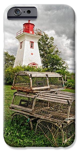 Lighthouse iPhone Cases - Prince Edward Island Lighthouse with Lobster Traps iPhone Case by Edward Fielding