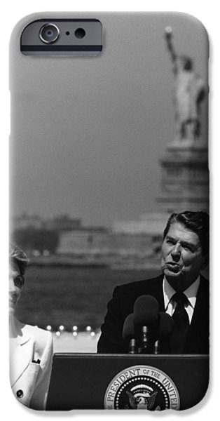 Reagan iPhone Cases - Reagan Speaking Before The Statue Of Liberty iPhone Case by War Is Hell Store