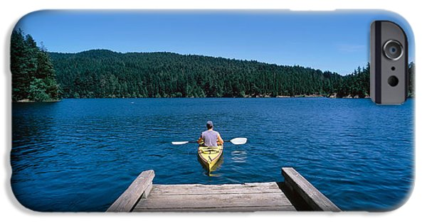 Getting Away From It All iPhone Cases - Rear View Of A Man On A Kayak iPhone Case by Panoramic Images