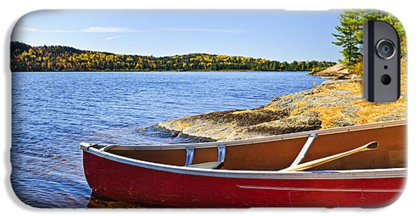 Paddle iPhone Cases - Red canoe on shore iPhone Case by Elena Elisseeva