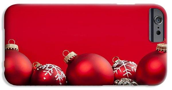 Festivities iPhone Cases - Red Christmas baubles and decorations iPhone Case by Elena Elisseeva