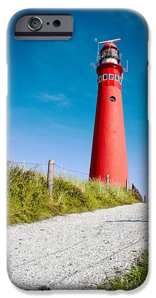 Built Structure iPhone Cases - Red lighthouse and deep blue sky. iPhone Case by Jan Brons