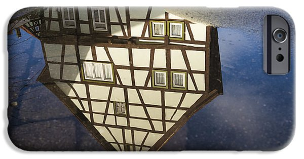 Asphalt iPhone Cases - Reflection of a beautiful old half-timbered house in a puddle of water iPhone Case by Matthias Hauser