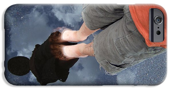 Asphalt iPhone Cases - Reflection of boy in a puddle of water iPhone Case by Matthias Hauser