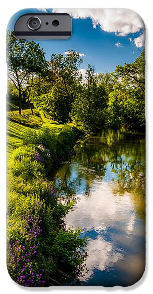 War iPhone Cases - Reflections of clouds and trees in Antietam Creek at Antietam National Battlefield iPhone Case by Jon Bilous