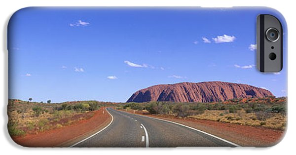 Red Rock iPhone Cases - Road And Ayers Rock Australia iPhone Case by Panoramic Images