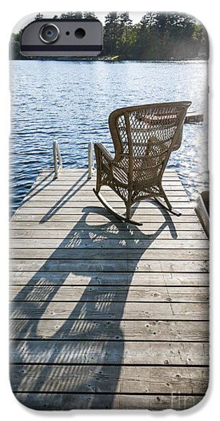 Wicker iPhone Cases - Rocking chair on dock iPhone Case by Elena Elisseeva