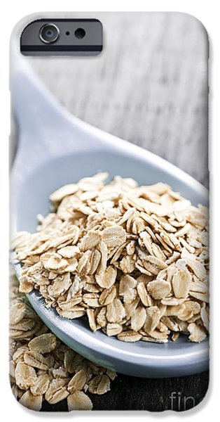 Oatmeal iPhone Cases - Rolled oats in spoon iPhone Case by Elena Elisseeva