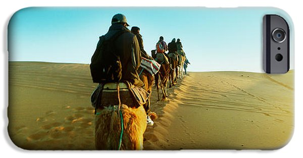 Sahara Sunlight iPhone Cases - Row Of People Riding Camels iPhone Case by Panoramic Images