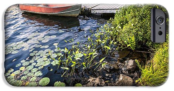 Green Canoe iPhone Cases - Rowboat at lake shore at dusk iPhone Case by Elena Elisseeva