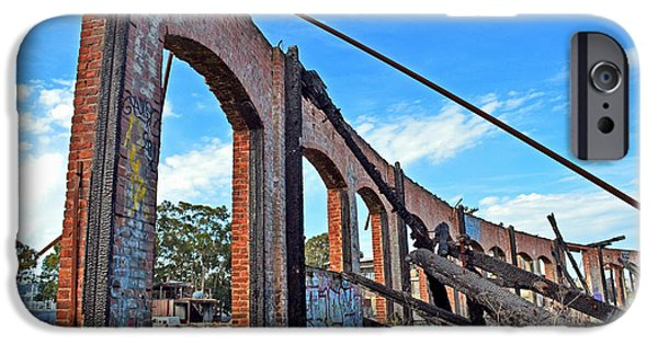 Electrical iPhone Cases - Ruins of the Old Train Roundhouse at Bayshore near San Francisco and the cow Palace iPhone Case by Jim Fitzpatrick