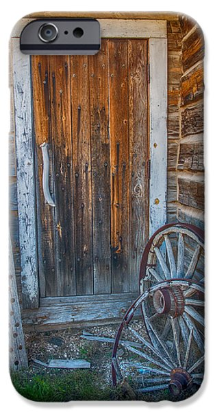 Log Cabin Art iPhone Cases - Rustic door and wagon wheels iPhone Case by Paul Freidlund