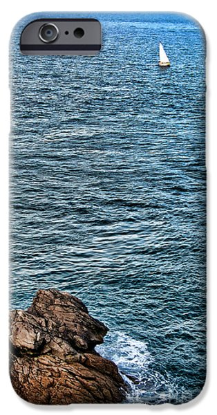 Sailing iPhone Cases - Sailboat along Rocky Coastline iPhone Case by Olivier Le Queinec